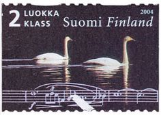 Postage stamp issued by Finland depicting swans and excerpt from a Sibelius score, The Swan of Tuonela.