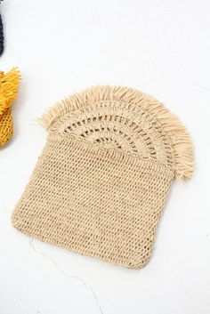 Crocheted raffia clutch bags, lined with magnetic snap. In ocher, natural or navy. 7 x Made by hand using natural materials sourced sustainably from Madagascar's precious forests.This post was discovered by Malla. Discover (and save!) your own Post Crochet Clutch Bags, Bag Crochet, Diy Clutch, Crochet Diy, Crochet Fringe, Crochet Handbags, Crochet Purses, Crochet Hats, Macrame Bag