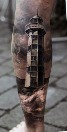 Light House Cloud Tattoo On Back Of Leg For Men