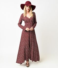 Mingle with something magnificent, dears! A perfectly primo seventies inspired maxi dress in a sweeping button up silhouette, crafted in a lightweight weave. Boasting a keyhole button v-neckline, gathered and banded at the empire waist with attached side