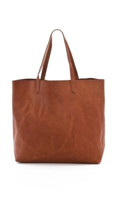 My go-to work bag: fits heels, laptop, makeup bag, notebooks, microphone -- you know, the journalist's kit!   Madewell Transport Tote