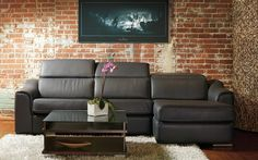 Cordoba Sectional in leather with adjustable headrests and motion seating.