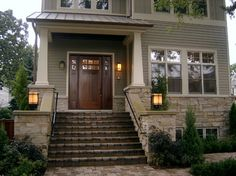 gray/beige/green siding, cream trim, dark wood door, stone lower facade. Hardie Board siding in Monterey Taupe with Sailcloth White trim. Stone: Windsor Tumbled, Weathered Edge from Eden Stone. Copper roof. www.follynbuilders.com