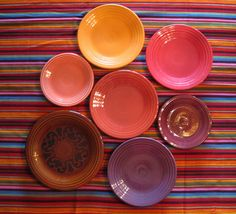 """I'd love to take a similar pic of this with mine. """"Fiestaware- Marigold, Heather, Persimmon, Paprika, Flamingo, Plum"""""""