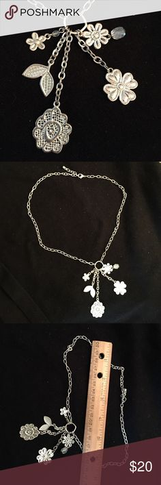 """🌻Weekend Sale🌻 Silver charm necklace Specialty shop purchase. Silver color with 5 charms on a ring. Necklace is 16"""" plus 3"""" extender. Looks great with a v-neck top. Jewelry Necklaces"""
