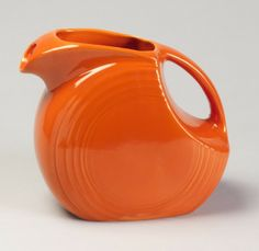 Fiesta Ware pitcher in Red w. great history of the design and color at the link | Smithsonian Cooper-Hewitt, National Design Museum in New York
