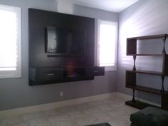 A custom designed TV panel with floating shelf/drawers give this wall a stylish focal point. #ranchointeriordesign.com Repin it.