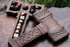 """Whether you hew, cleave, or cut, protect your beloved polys in this high quality thematic case. This solid piece of hardware comes in a variety of options - you pick the wood, felt color, and design. Dice Guards measure approximately 6"""" x 10"""" x 1.75"""". All wood is hand selected for durability, beauty, and a lifetime of gaming. The magnets are 0.25"""" rare earth neodymium and give a satisfying snap when closed (they are incredibly strong!)"""