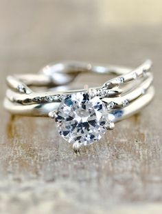 diamand engagement ring with  unique wave-like band