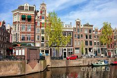 Historic Dutch houses in Amsterdam by the Geldersekade canal, Netherlands, North Holland province