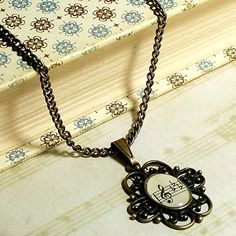 Treble Clef 1927 Sheet Music Necklace by BrassAndChain on Etsy, $16.00