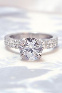 This diamond engagement ring is a classic eternity style with a modern twist with the shared prong accent diamonds around the band. The center is 1.9 carats. TAP to learn more and browse 1,000+ unique engagement rings!