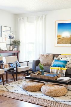 Shana:  Rugs on rugs on rugs.  A living room quickly transforms into a welcoming bohemian haven with floor poufs and cushions in varying textures and colors. Allow for storage that's easy on the eye by placing them under a coffee table with clean lines Shop this look: Basket Weave Floor Poof - Gold Floor Poof via Waiting on Martha  via @AOL_Lifestyle Read more: http://www.aol.com/article/2015/09/24/the-must-have-piece-every-home-should-have/21238525/?a_dgi=aolshare_pinterest#fullscreen