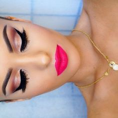 Love this makeup look - dramatic pink/brown smokey eye with winged eyeliner and bright pink lips | thebeautyspotqld.com.au