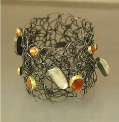 Bracelet |  Anna Heindl. Sterling with black lacquer, gold, amber and other stones.