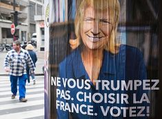 """posters in Paris showing Marine Le Pen as Trump. It reads """"Make no mistake. Choose France. Vote!"""""""