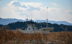 A fishing vessel carried by the 11 March 2011 tsunami remains inland in the town of Namie Japan Earthquake, Earthquake And Tsunami, Tsunami 2011, Places Around The World, Around The Worlds, Fishing Vessel, Nuclear Disasters, Abandoned Hospital, Fukushima