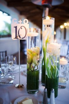 Submerged centerpieces with orchids, calla lilies, and tulips  Santa Barbara wedding flowers Bacara  Green, Navy, and White florals