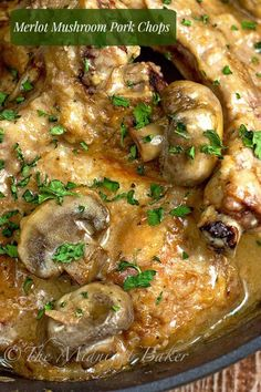 Merlot Mushroom Pork Chops ~ pork chops in a creamy merlot sauce that are easy enough for a weeknight meal but fancy enough for company! | bakeatmidnite.com