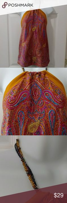 """Boho Hippie Silk Paisley Scarf Halter Top NWOT What's not to LOVE about this boho hippie festival silk scarf style hem beaded neck halter top!!! Gemstone color paisley print with METALLIC thread paisley accents, elasticized upper back.  100% silk (fabric is doubled to form a lining ...dry clean only. NWOT! Measurements: Bust 16"""" armpit to armpit & length varies due to scarf style, but 16.5"""" from armpit to hem at side.  SIZE SMALL Frox Tops Tank Tops"""