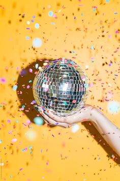 Hand holding a disco mirrors ball with confetti by CACTUS Creative Studio - Disco, Party - Stocksy United Disco Party, Disco Theme, Disco Disco, Neon Party, Look Disco, Accessoires Photobooth, Promo Flyer, Mirror Ball, Nouvel An