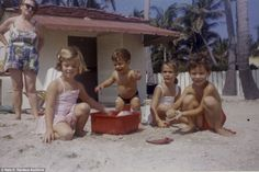 Sun and sand: The Kennedy children are pictured enjoying a day at the beach