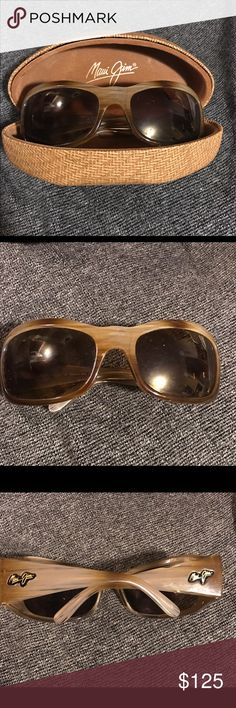 Maui Jim sunglasses! Perfect condition. Worn twice. No scratches or flaws of any kind. Comes with case. The inner part of the case seems to be separating from the hard outer layer of case. That would be the only issue with the case :) make me a reasonable offer Maui Jim Accessories Sunglasses