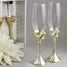 Set Of 2 Gold Heart Themed Toasting Flutes- Raise a toast at your grand celebration with our magnificent golden champagne flutes! This elegant set of
