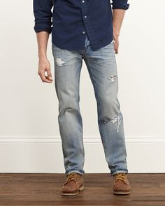 Light wash with fading and whiskering throughout, hand-done destruction detailing, classic five pocket styling with heritage logo tab at left pocket, signature back pocket stitching, Imported