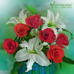 Roses and oriental lilies thrown together in an exclusive arrangement.