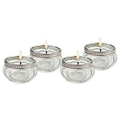 Light up your reception style with Lillian Rose's charming Glass Tealight Holders. These elegant candle holders are beautifully crafted in glass and embellished with a silvery rim that will add a soft, romantic glow to your special day.
