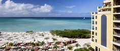 Relax on the beach with a cool beverage at The Ritz-Carlton, Aruba.