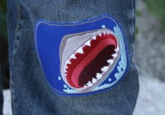Fun and easy iron-on shark to repair kids clothes, cover a stain, or just for fun. How To Patch Jeans, Patch Pants, Cool Patches, Iron On Patches, Repair Jeans, Recycled T Shirts, Recycle Jeans, Patched Jeans, Denim And Lace
