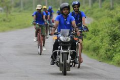 You ride while leading the way in this manner.  http://bangladesh.cog-way.net/