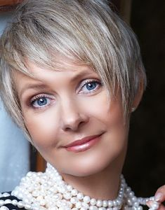 A short blonde straight coloured multi-tonal mature hairstyle by Mature Web Collection