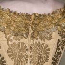 Back detail of gold brocade ball gown c. 1880.