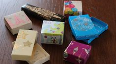 Gift boxes made from recycled Christmas cards.