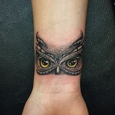 If you enjoy tattoos, you might look at an owl tattoo which might not be one of the known common tattoos, yet it's popular. They are gener. Owl Eye Tattoo, Owl Tattoo Small, Small Wrist Tattoos, Owl Tattoo Wrist, Cute Owl Tattoo, Tattoo Bird, Wrist Tattoo Cover Up, Cover Up Tattoos, Body Art Tattoos
