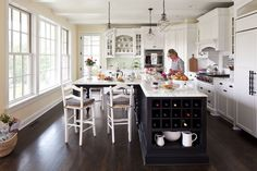 L shaped island, table seating, wine storage! @Sherry Clemens. Martha O'Hara Interiors