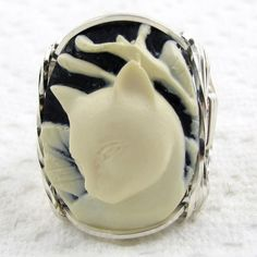 Calla Lily Cat Cameo Ring Sterling Silver Lovely and large 18x25mmoval shaped molded resin fashion cameo hand sculpted in the finest Jeweler's .925 Sterling Silver custom designed setting.