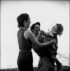 """Fisherman and family. Bahía Honda, Cuba. 1954.© Eve Arnold/ Magnum Photos:""""Magnum dispatched [Eve Arnold] to Cuba and Haiti to take pictures for magazine projects that [Robert] Capa had arranged. In both countries, she was confronted with destitution on a level she had never seen, beyond even the migrant farm workers. A Cuban family she was photographing begged her to adopt their nine-year-old daughter, Juana, to save her from a life of poverty and prostitution, and she was so moved by them…"""