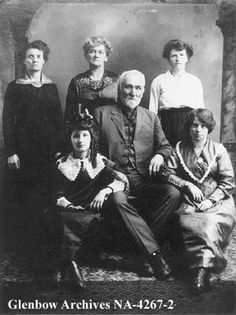 Ambroise Lepine, a Metis pioneer with his daughters-in-law and daughter, St. Boniface, Manitoba.  Date: [ca. 1920]  Remarks: Back row L-R: Izilda Lapine, wife of Louis; Cleophe Laurence, nee Lepine; Marie Lepine, wife of James.  Front row L-R: Lorette Laurence, granddaughter; Ambroise Lepine; Dolly Lepine, wife of Narcisse.