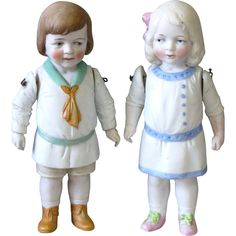 Charming 7 Pair of All Bisque Hertwig Children with Lovely Molded Clothing