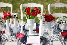 Perfect example of how I like milk glass centerpieces!