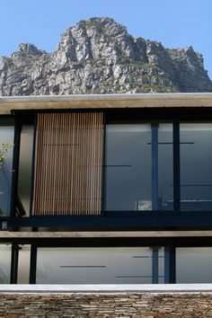 House Elaysian, Cape Town  Black steel frame and vertical timber slats sliding shutter, by Rivets+Rockets