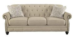 tufted-ivory-sofa-with-nailhead-trim