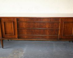 Mid-Century Modern Credenza with a really chic design, has metal accents, and a white laminate top that would be perfect for a nursery!
