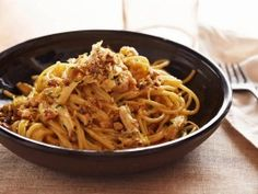 Giada turns carbonara pasta into a filling meal by adding shredded roasted chicken and chopped walnuts to the indulgent eggy, bacon-y dish.