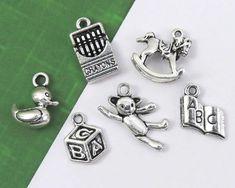 8 Piece Tibetan Silver Sports Theme Mixed Charm Set