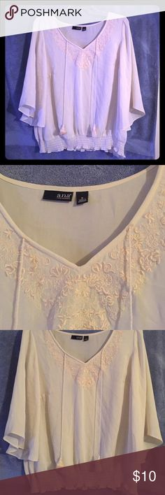 Cream top with tassels Embroidered neck line with elastic bottom. Nice with jeans, skirt or dress pants. Very versatile. a.n.a Tops Blouses